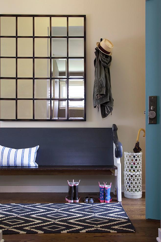 Entryway - contemporary dark wood floor entryway idea in Chicago with beige walls