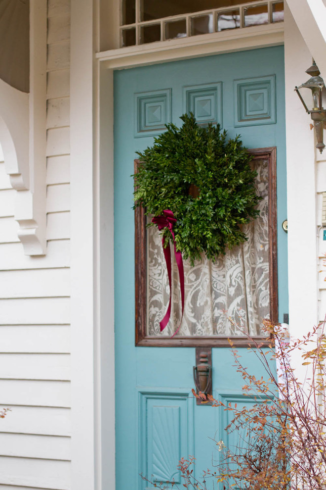 Example of a classic entryway design in New York with a blue front door