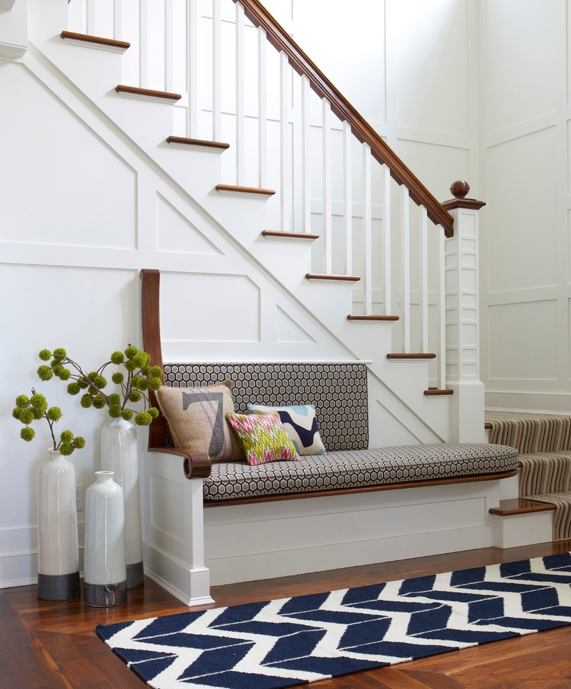 Beach style light wood floor foyer photo in Boston with white walls