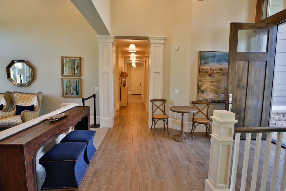 Large light wood floor entryway photo in Salt Lake City with white walls and a dark wood front door