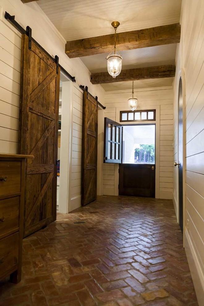 Dutch front door - country brick floor dutch front door idea in Birmingham
