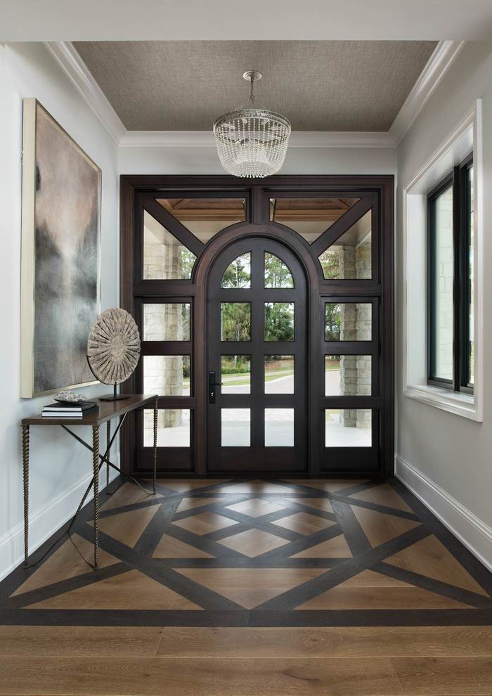 Inspiration for a transitional dark wood floor and brown floor single front door remodel with gray walls and a glass front door