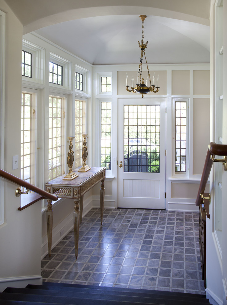 Inspiration for a timeless ceramic tile entryway remodel in New York