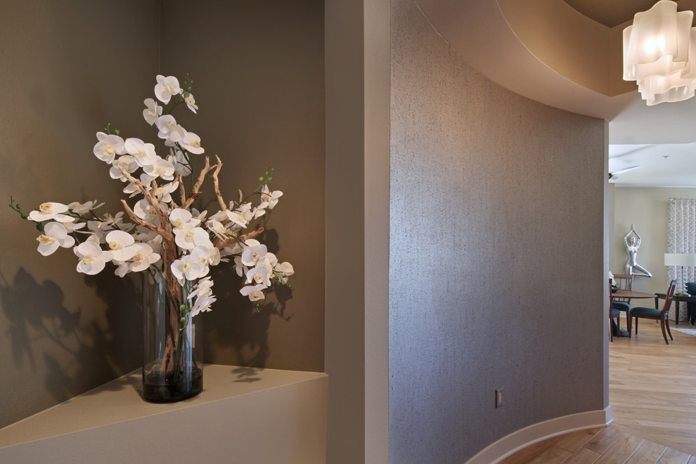 Trendy foyer photo in Orange County with metallic walls