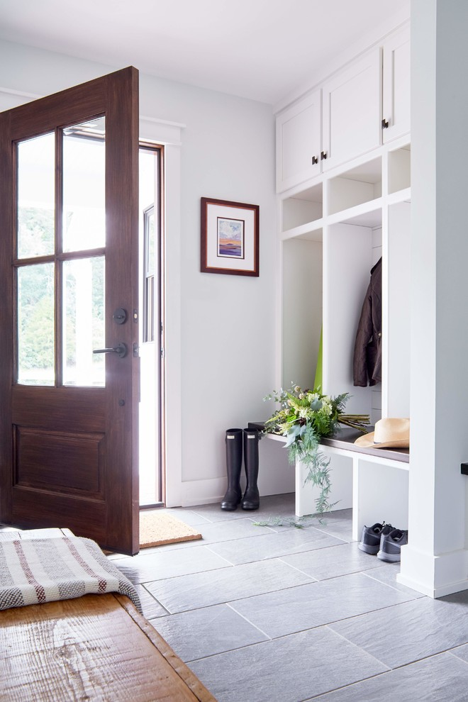 Entryway - mid-sized country gray floor and porcelain tile entryway idea in Richmond with white walls and a dark wood front door