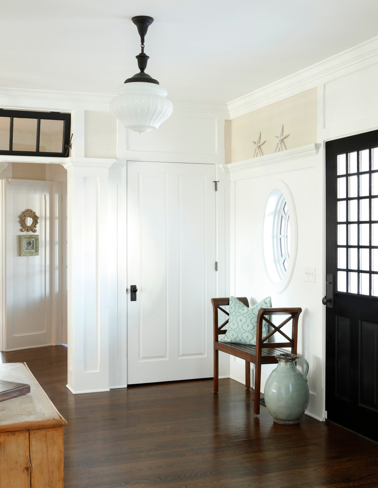 Inspiration for a timeless entryway remodel in New York with a black front door