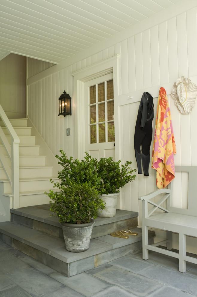 Elegant slate floor entryway photo in Los Angeles