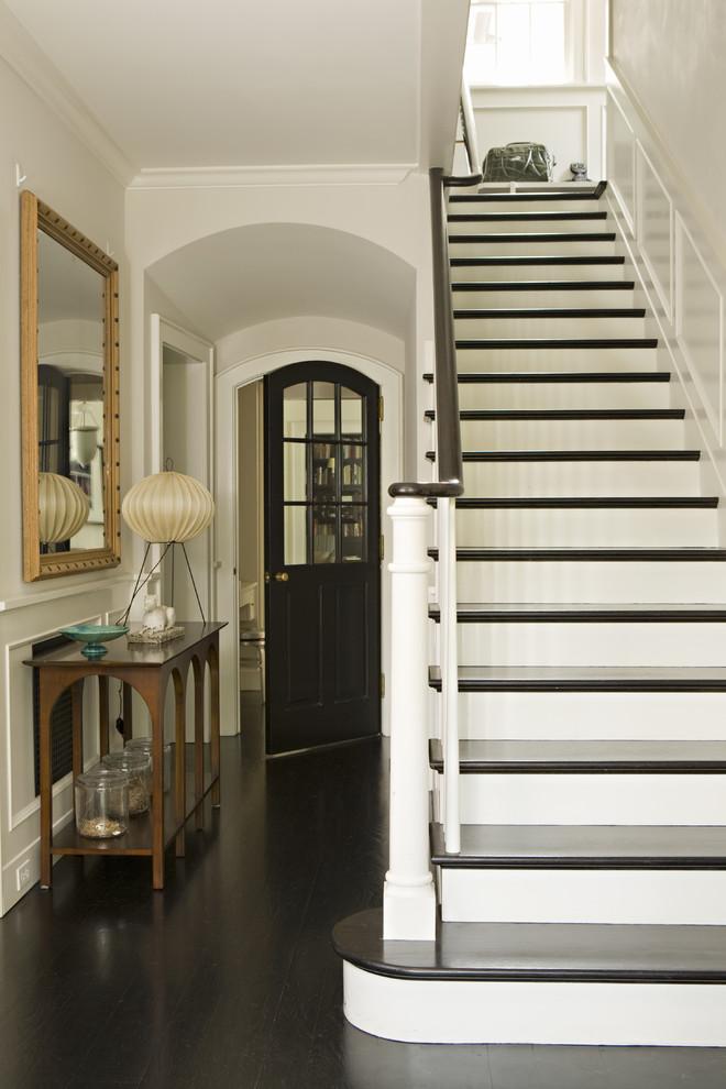 Ornate dark wood floor and black floor entry hall photo in Los Angeles