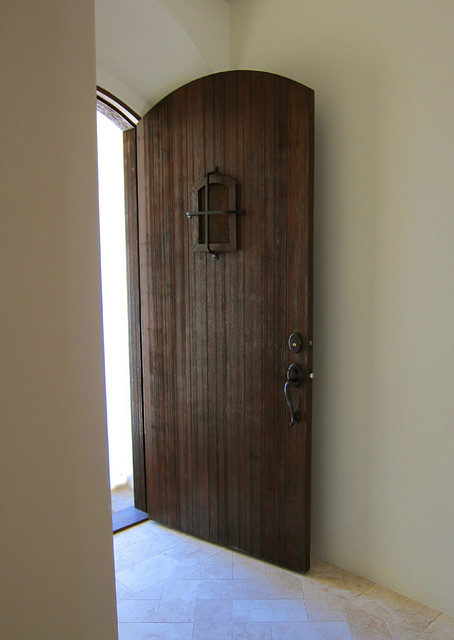 Rustic entry door for a small spanish cottage in montecito for Mediterranean style entry doors