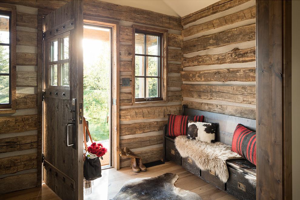 Inspiration for a rustic light wood floor and beige floor single front door remodel in Other