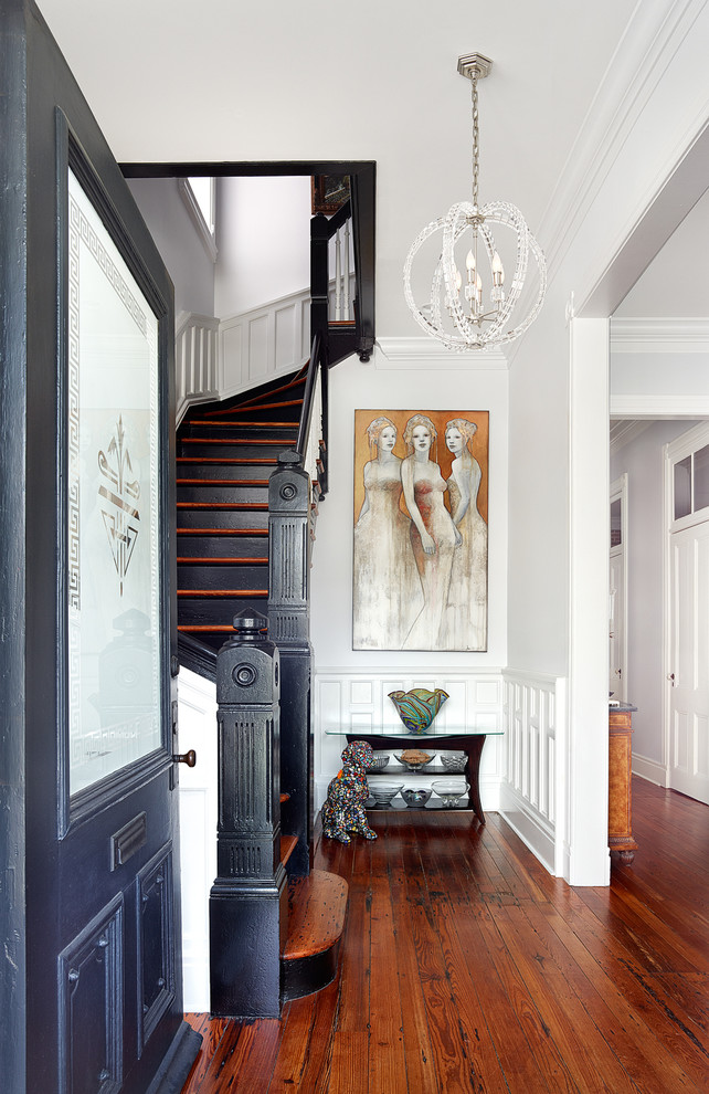 Transitional medium tone wood floor and brown floor single front door photo in Charleston with white walls and a glass front door