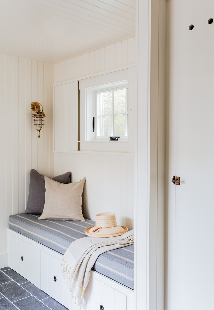 Example of a transitional marble floor and blue floor mudroom design in Boston with white walls