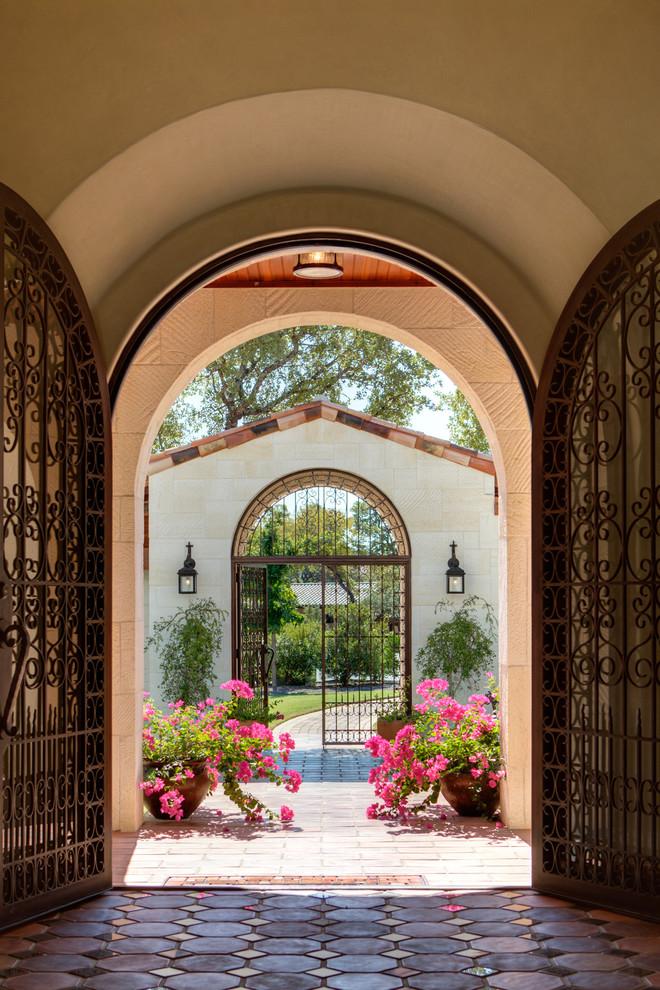 Double front door - mediterranean double front door idea in Austin with a metal front door