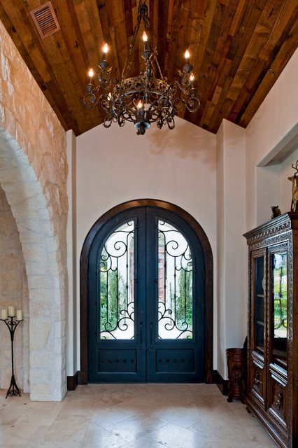 Santa barbara style in austin for Mediterranean style entry doors