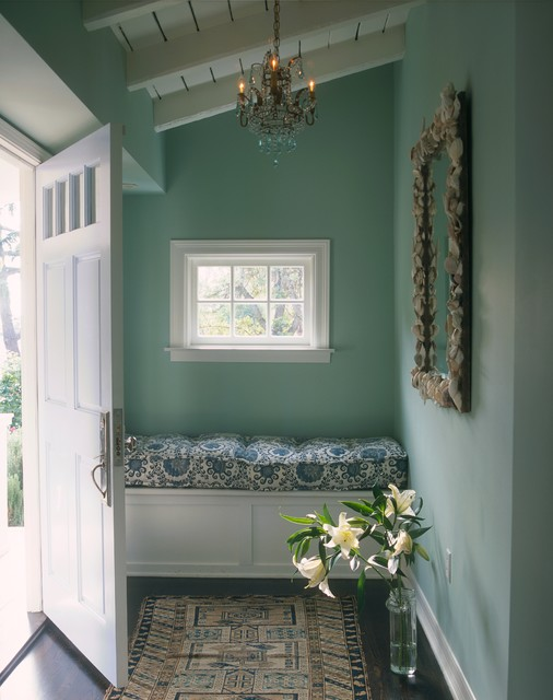 Example of a small classic single front door design in Los Angeles with blue walls