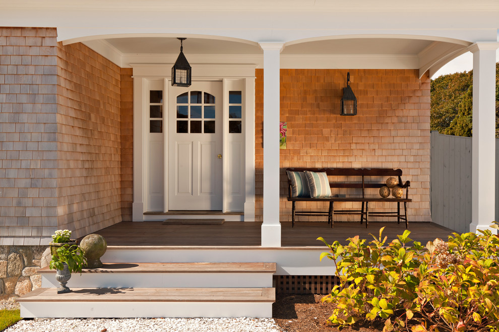 Elegant entryway photo in Boston with a white front door