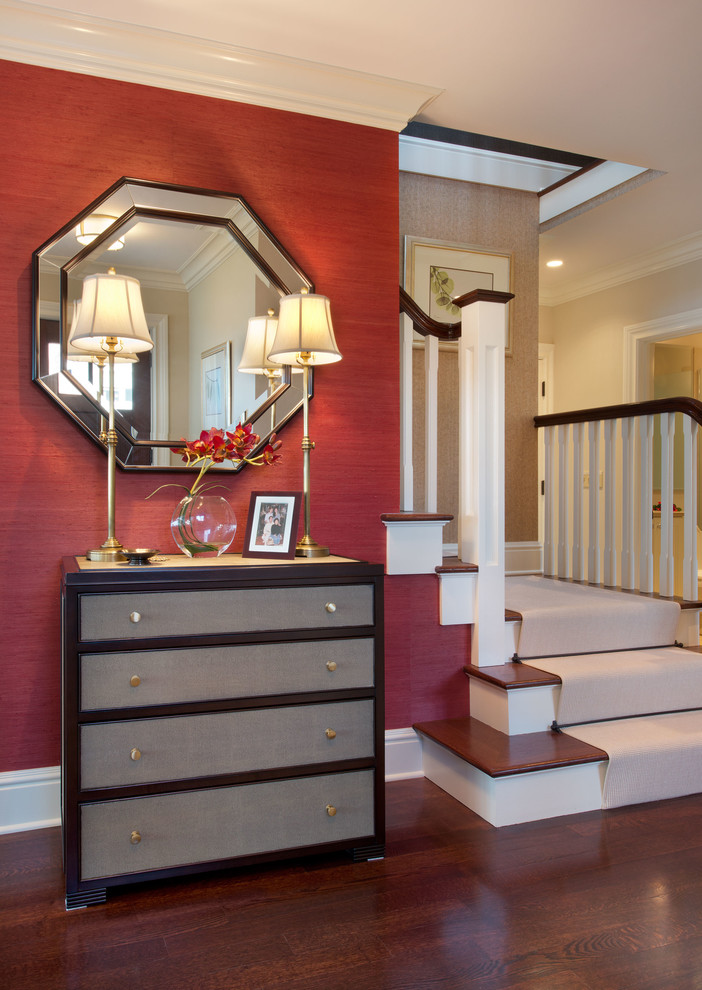 Example of a mid-sized eclectic dark wood floor and brown floor entryway design in New York with red walls and a dark wood front door