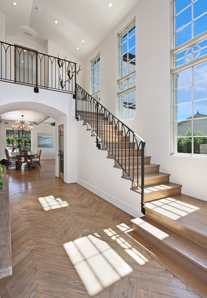 Example of a beach style entryway design in Orange County with white walls
