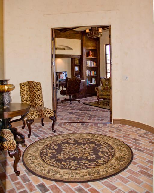 Inspiration for a mediterranean brick floor foyer remodel in Austin with beige walls