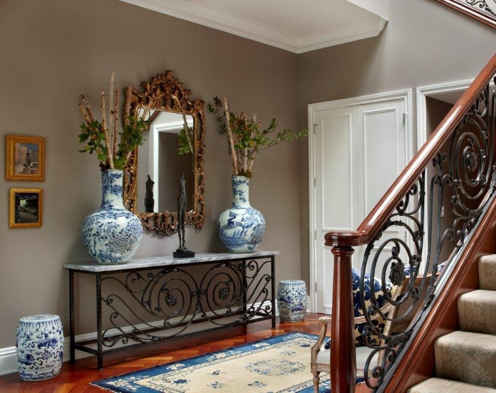Foyer - mid-sized traditional dark wood floor and brown floor foyer idea in Chicago with gray walls