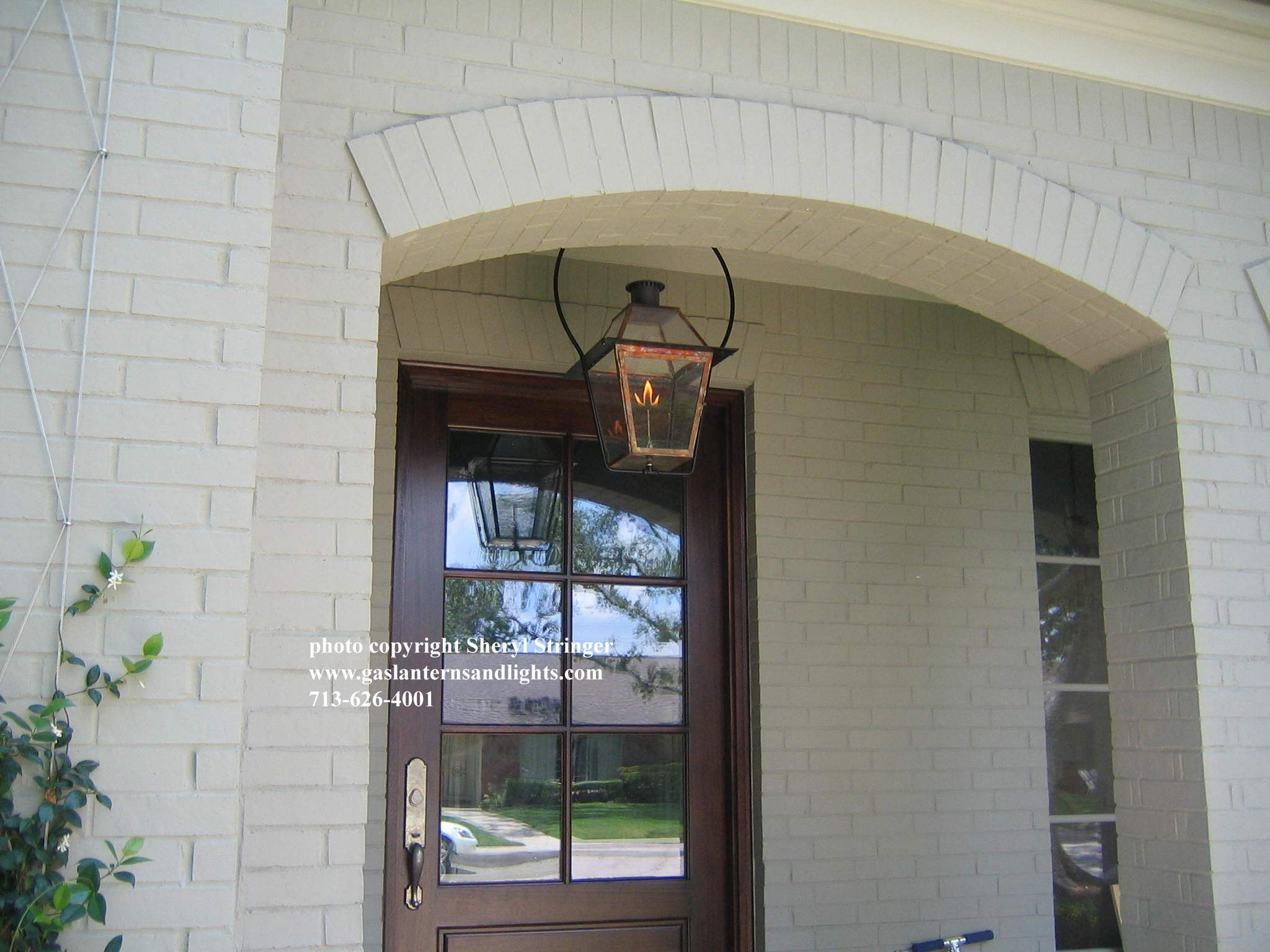 Sheryl's New Orleans Style Gas Lantern with Glass Top Hanging by Steel Yoke