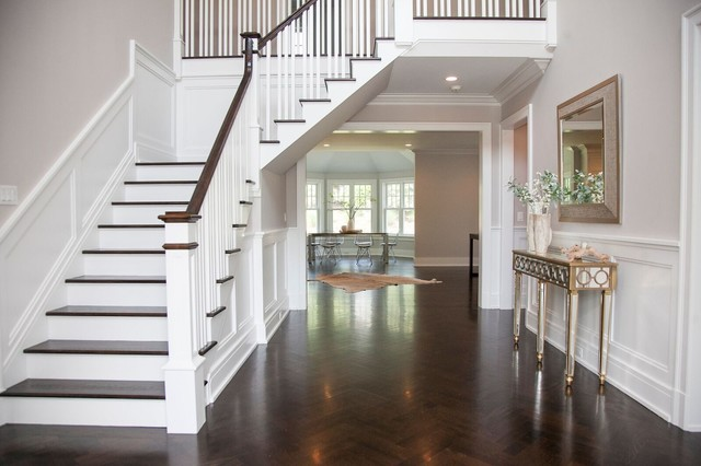Inspiration for a large transitional dark wood floor foyer remodel in New York with white walls