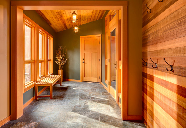 Inspiration for a mid-sized craftsman gray floor entryway remodel in Other with multicolored walls and a medium wood front door