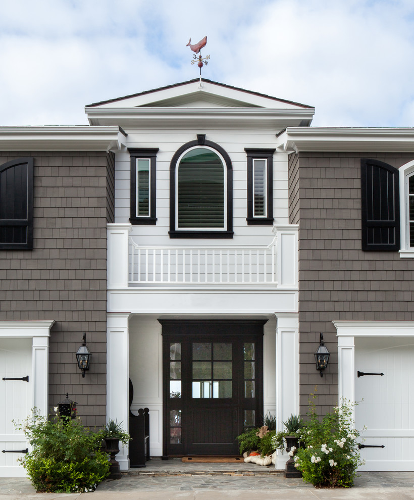 Coastal entryway photo in Orange County with a glass front door