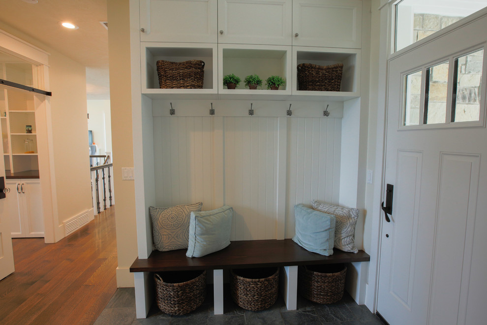 Inspiration for a large transitional entryway remodel in Salt Lake City with beige walls and a white front door
