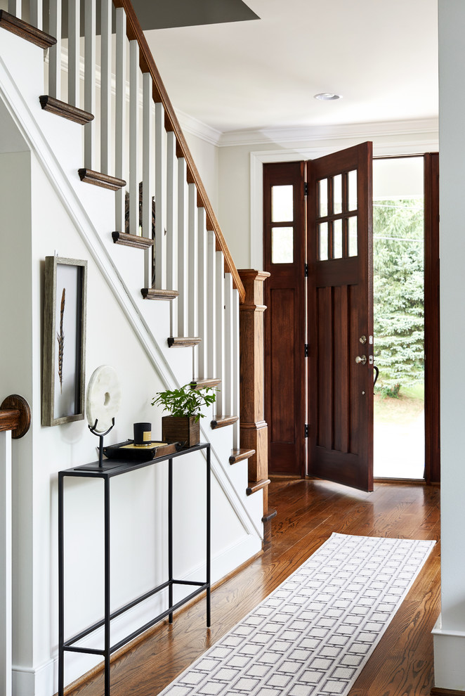 Inspiration for a mid-sized transitional brown floor and dark wood floor entryway remodel in DC Metro with beige walls and a dark wood front door