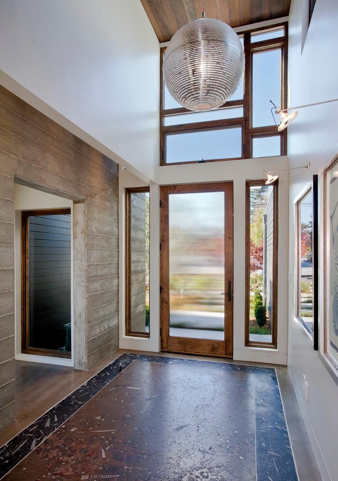 Inspiration for a contemporary concrete floor entryway remodel in San Francisco