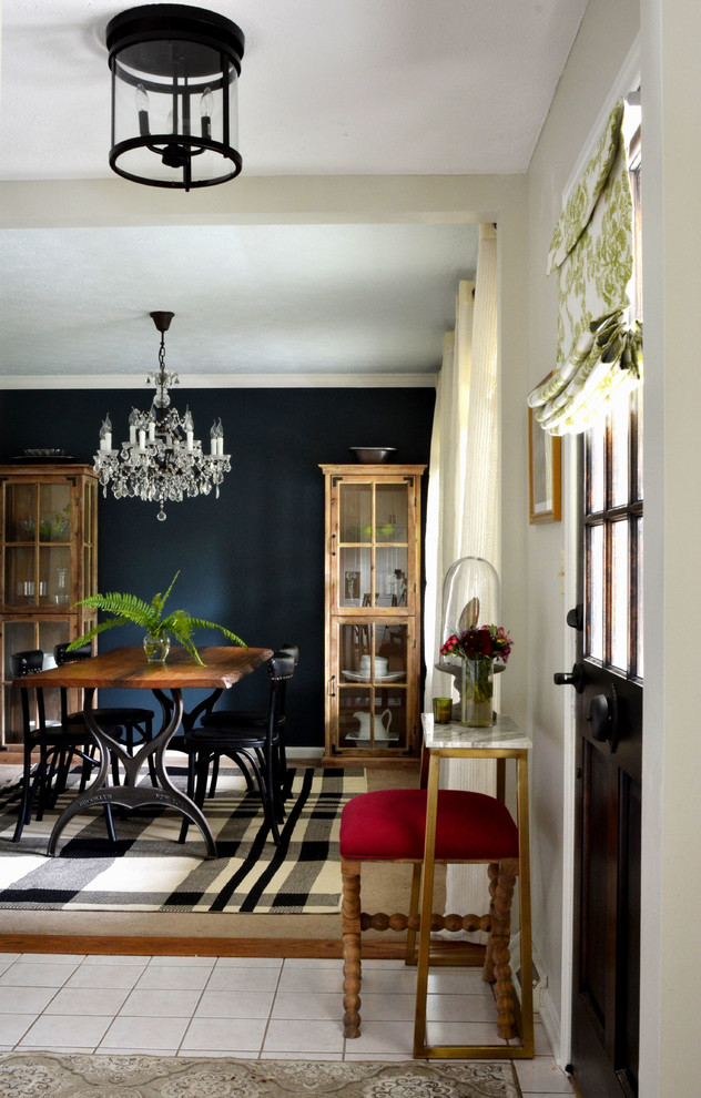 Inspiration for a small eclectic entryway remodel in Houston with gray walls and a dark wood front door