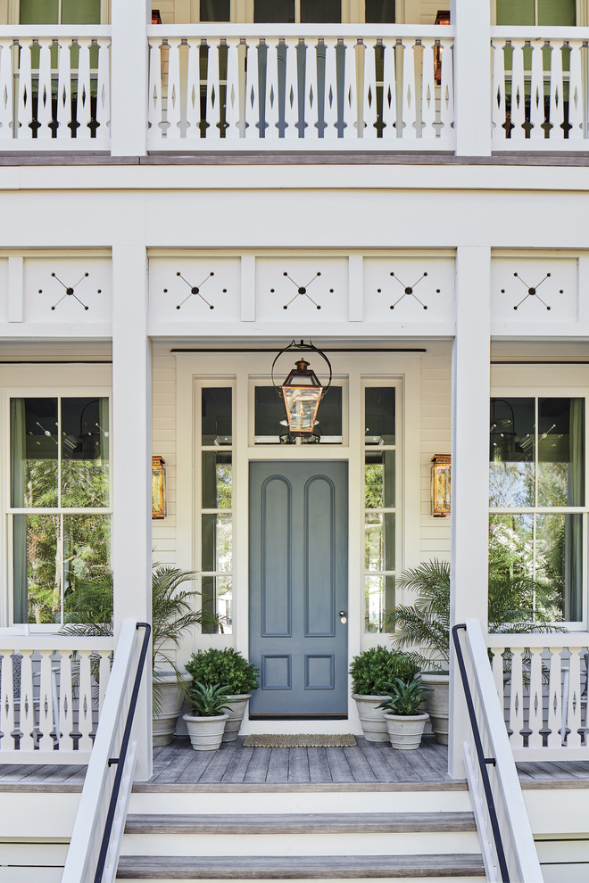 Beach style entryway photo in Jacksonville with a gray front door