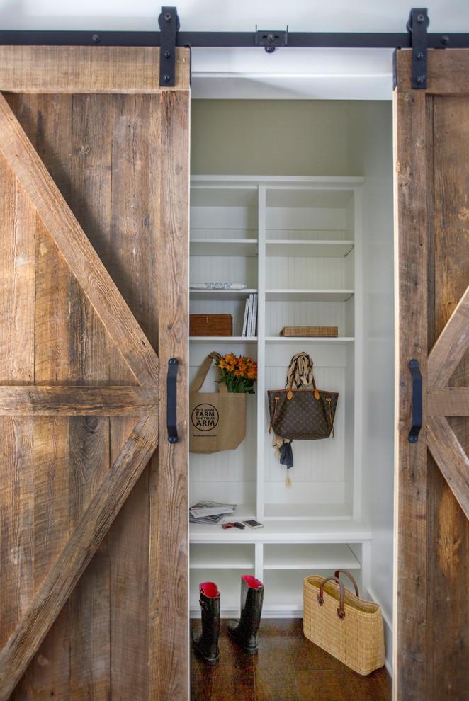 Inspiration for a mid-sized cottage dark wood floor mudroom remodel in Jacksonville