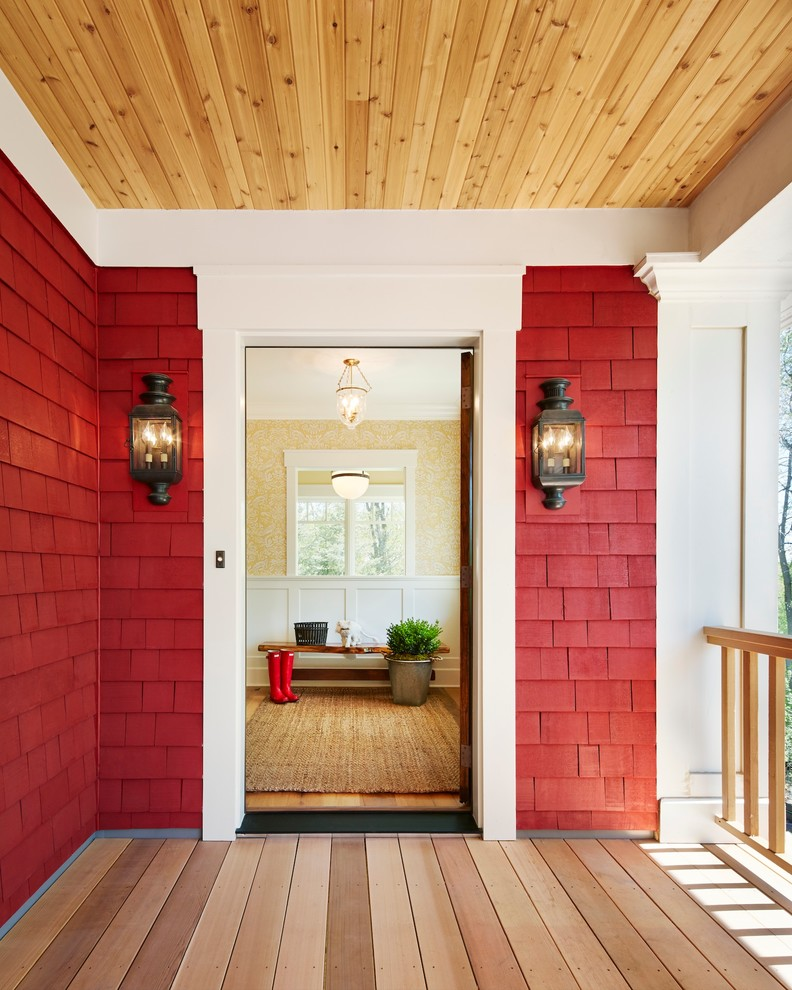 Entryway - mid-sized cottage light wood floor entryway idea in Minneapolis with red walls and a medium wood front door