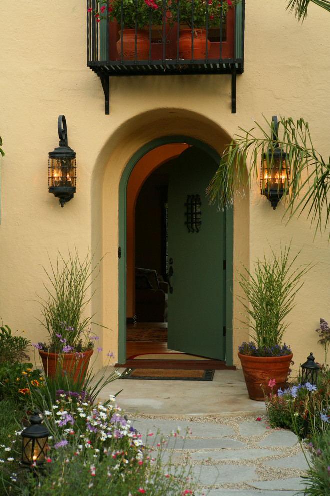 Inspiration for a mediterranean entryway remodel in Los Angeles with a green front door