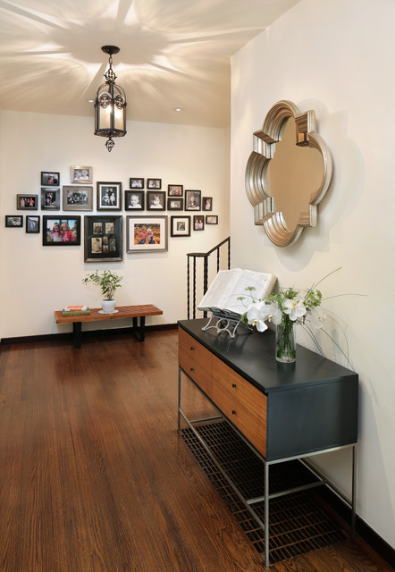 Example of a mid-sized transitional dark wood floor foyer design in San Francisco with white walls