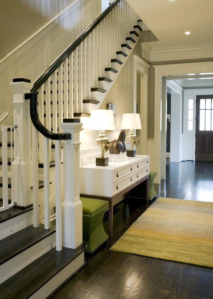 Entryway - traditional dark wood floor and black floor entryway idea in Atlanta with beige walls