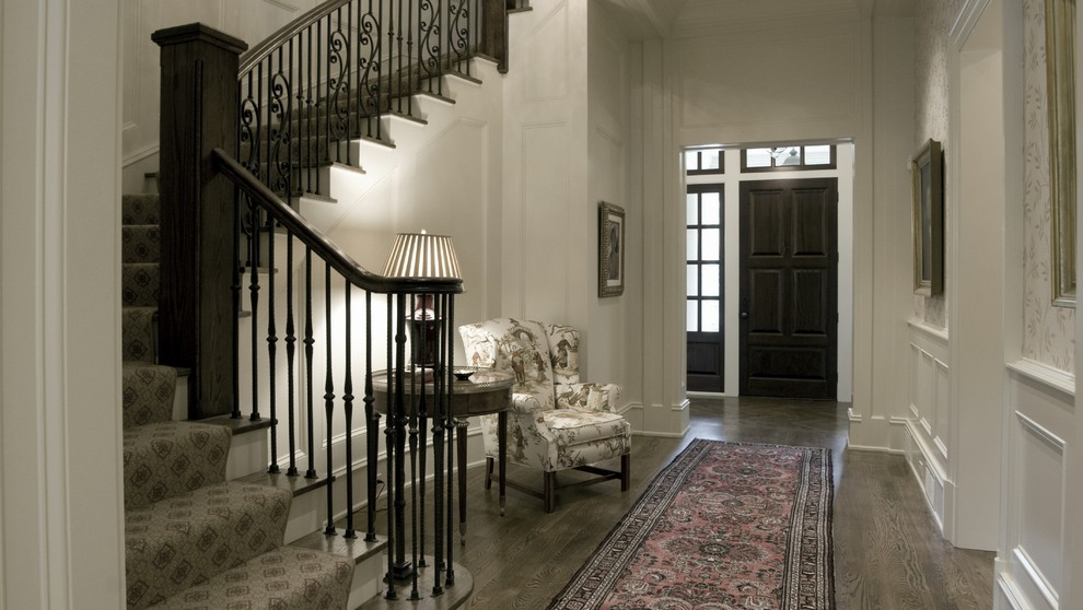 Entryway - mid-sized traditional dark wood floor and brown floor entryway idea in Atlanta with white walls and a dark wood front door