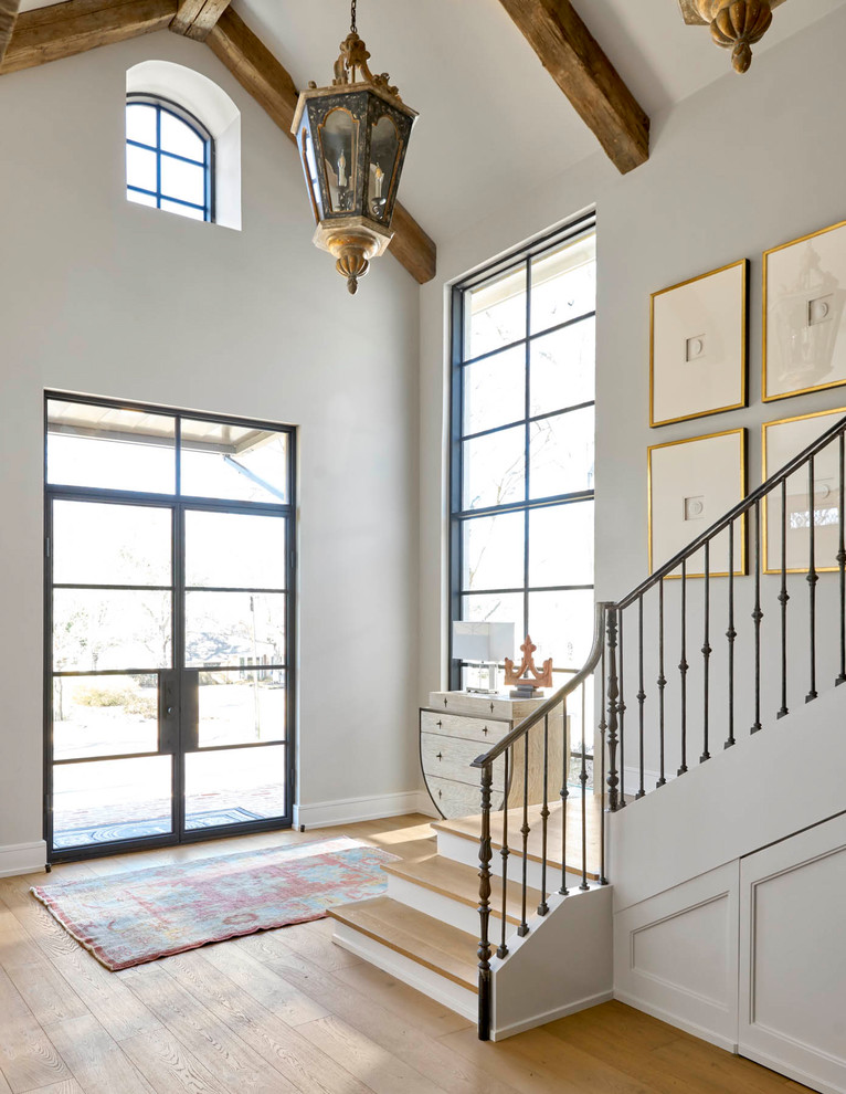 Inspiration for a mid-sized transitional light wood floor and beige floor entryway remodel in Dallas with gray walls and a glass front door