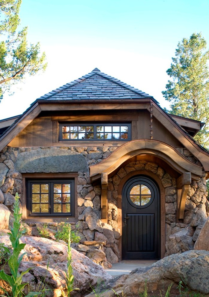 Inspiration for a small rustic single front door remodel in Denver with a black front door