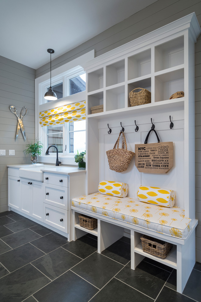 Mudroom - transitional black floor mudroom idea in Portland with gray walls