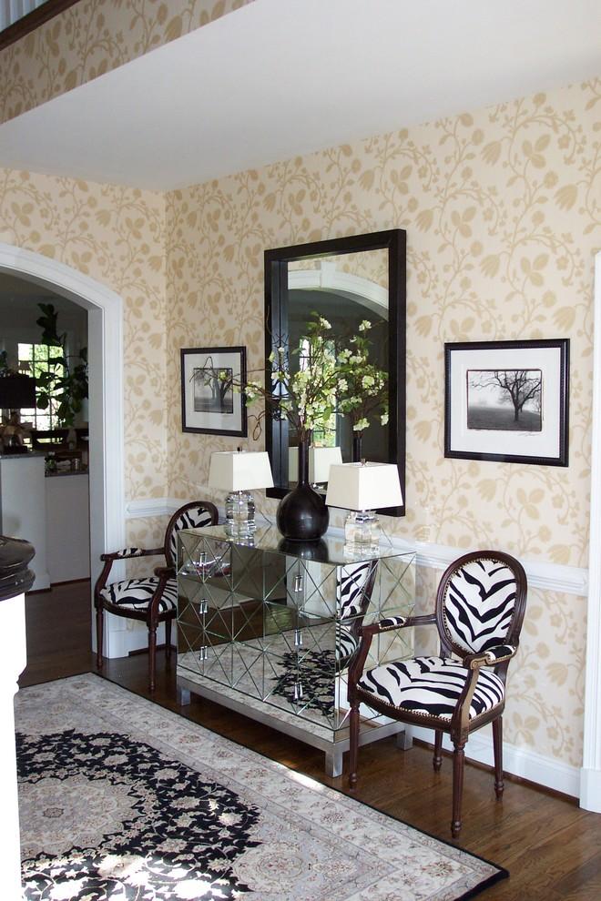 Ornate dark wood floor entryway photo in Richmond with beige walls
