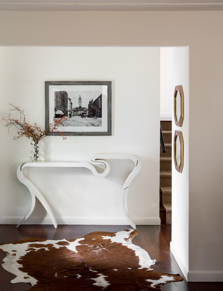 Inspiration for a small transitional dark wood floor and brown floor entry hall remodel in Denver with white walls