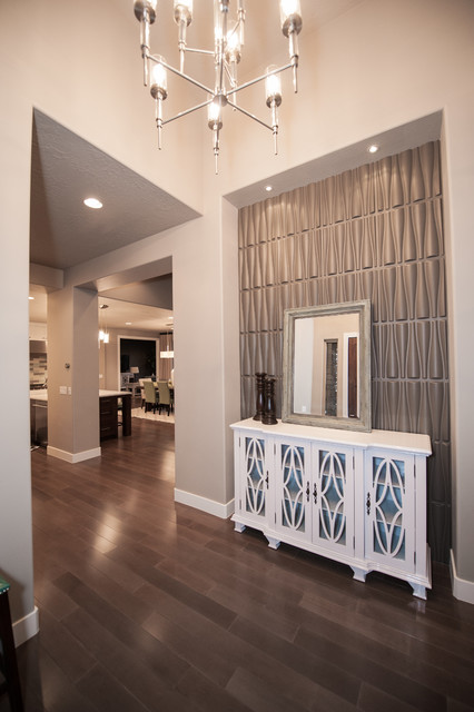 Mid-sized trendy dark wood floor and brown floor foyer photo in Salt Lake City with gray walls