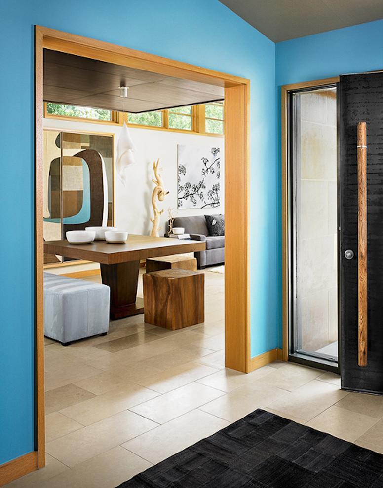 Entryway - beige floor entryway idea in Austin with blue walls and a black front door