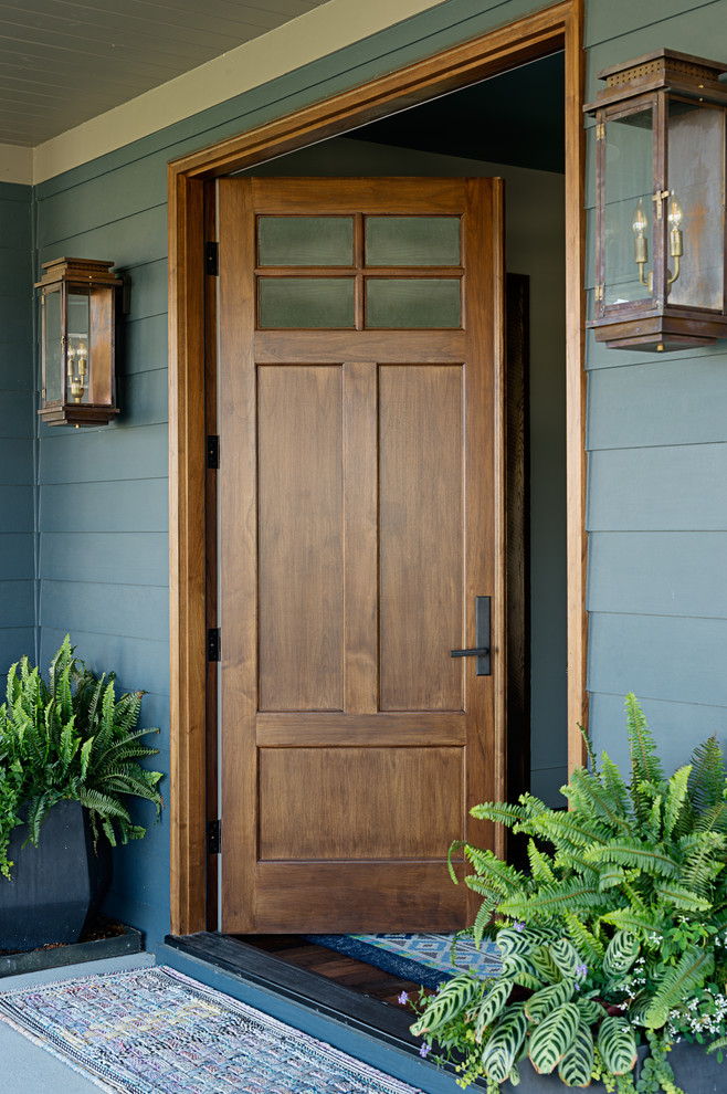 Mid-sized elegant entryway photo in Nashville with a medium wood front door and blue walls