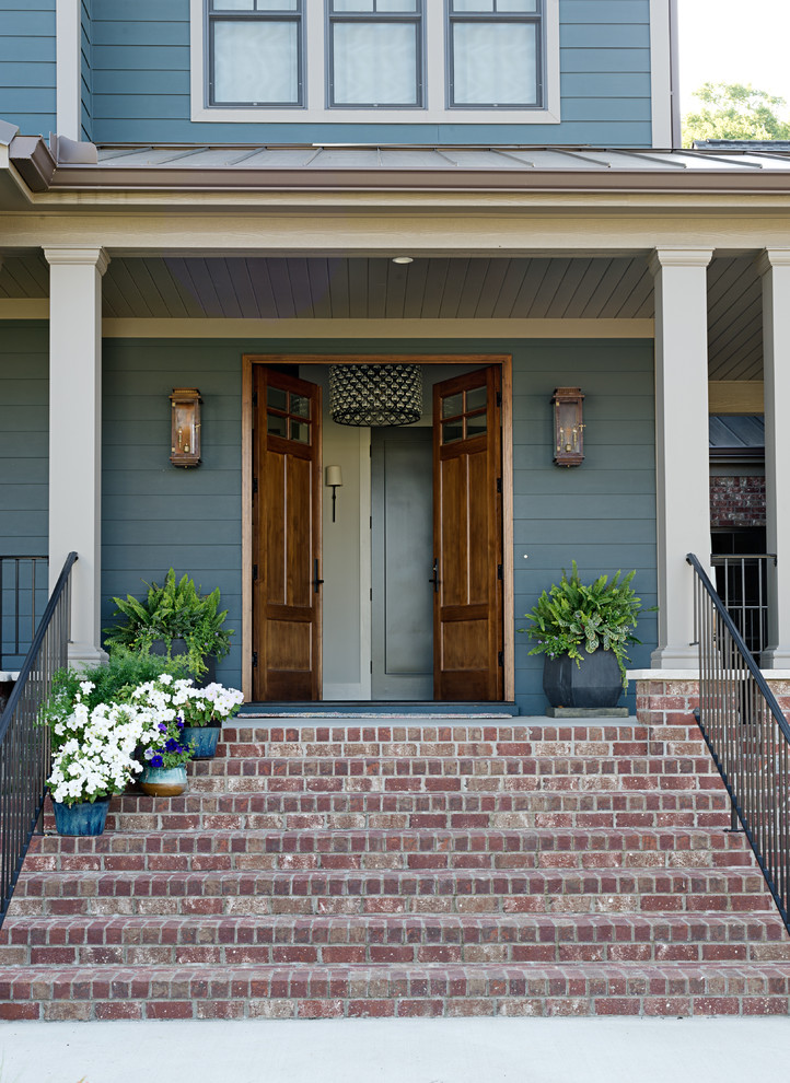 Mid-sized transitional entryway photo in Other with a medium wood front door