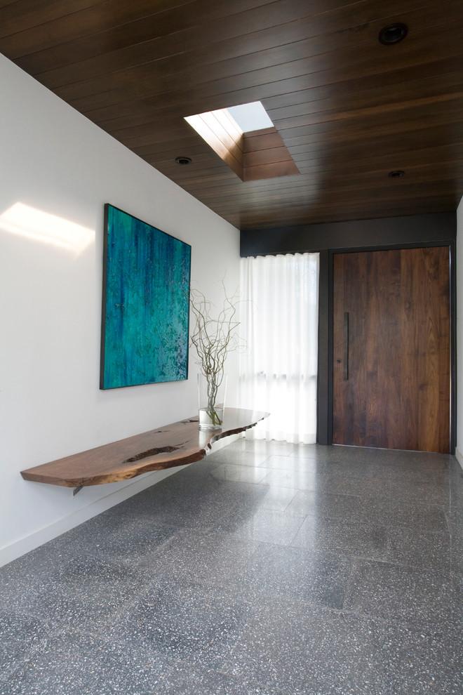 Entryway - modern concrete floor entryway idea in San Diego