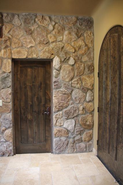 Textures: Rock wall, rusted metal door frame, arched entry door ...